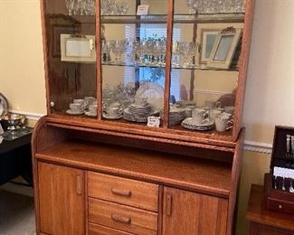 Matching hutch with unique roll top cabinet feature.