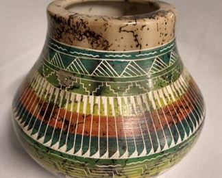 Signed pottery, AA. $125