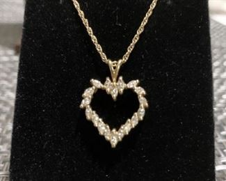 Heart shaped 14 k diamond pendant on 18 inch chain. Chain includes safety latch and weighs 4.0 g.