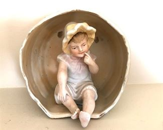 "$40 Porcelain girl with bonnet.  5"" W, 3"" D, 5"" H."