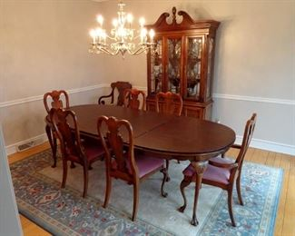 American Drew Cherry dining room suite. Includes table with two extension leaves, six chairs and Dansk pads and cherry Federal style china cabinet.
