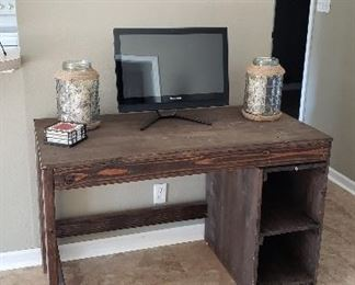 Handmade wooden desk, small tv, artist made wooden state of AR
