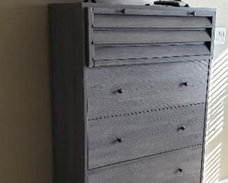 gray distressed chest of drawers, flat screen television