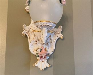 1 of two wall sconces that match the Capodimonte chandelier.