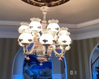 12 lights Capodimonte chandelier with beautiful details and lights encased in a glass globe finished look.  2900.00 OBO