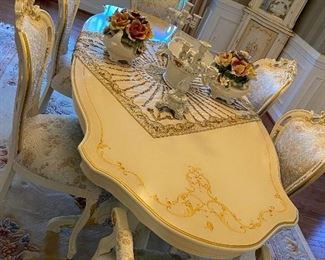 Beautiful Celiné Italian made high end dinning table with 6 chairs. Two arm chairs and 4 regular chairs in meticulous condition.  8500.00