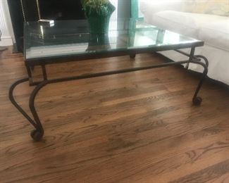$475 -- Carlisle Design Wrought Iron Coffee Table with beveled glass.  4'x4' (including extension of curved legs).  Excellent condition.