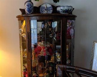one of three curio cabinets
