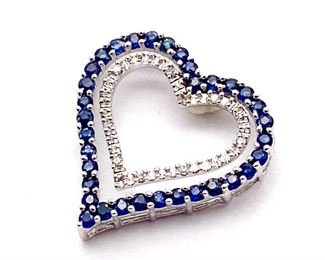 Natural blue Sapphire and Diamond heart estate pendant in 10k white gold weighing 1.77 grams  Chain not included.   Retail Estimate: $2150