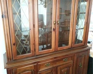 """https://ctbids.com/#!/description/share/713101 Beautiful Broyhill solid pine cabinet with lighting on top shelf. Piece does come apart into 2 pieces for easier lifting. Measurements are 63""""x80""""x18""""."""