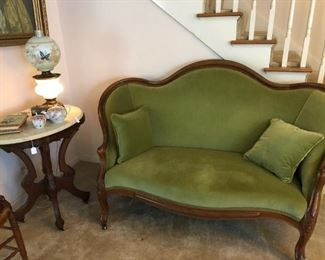 Antique settee, original finish. Upholstered in green.  $750. Available for sale EARLY.