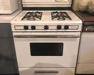 "Gas Stove by Magic Chef with bottom warmer. Works fine but needs cleaning, 30"" x 28"" x 37""   $100"