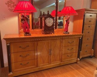 Beautiful dresser and lingerie chest with black column detail; pair of Blackamoor figural lamps . . . the figures are black with red red turban hats and Aladdin pant clothing.