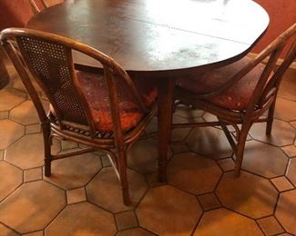 """Antique round table with 6 rattan and cane chairs.  47"""" diameter x 29""""h.  Also has a 10"""" leaf to create an oval 57""""l x 47""""wide.  $380"""