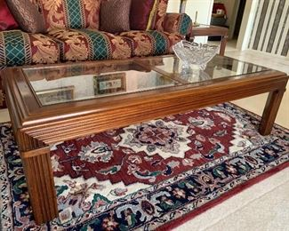 Coffee table, wood with removable inset glass panels top, sitting on Indian rug