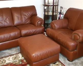 Genuine Leather love seat and oversize chair.