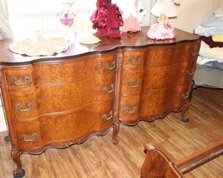 serpentine front dresser, with ornate mirror