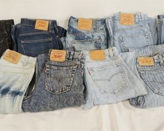 1006LOT OF NINE PAIRS OF VINTAGE USA MADE LEVI STRAUSS & COMPANY JEANS W/ RED TABS. SIZES ARE; 33 X 32, 32 X 30, 33 X 30, 31 X 30, 31 X 34, & THREE PAIRS ARE SIZE 32 X 32. VARYING DEGREES OF WEAR