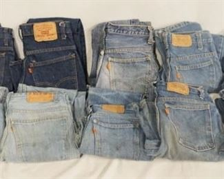 1007LOT OF TEN PAIRS OF VINTAGE LEVI STRAUSS & COMPANY JEANS W/ ORANGE TABS. LOT INCLUDES A PAIR OF BELL BOTTOMS SIZE; 27 X 30. THE REST ARE SIZES; 29 X 34, 26 X 31, 27 X 27, 26 X 29, 29 X 32, 26 X 27, 27 X 32, 29 X 30 & ONE PAIR IS MISSING THE SIZE MEASURES APP. 27 IN WAIST. VARYING DEGREES OF WEAR