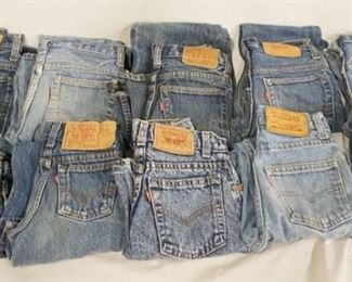 1012LOT OF TEN PAIRS OF LEVI STRAUSS & COMPANY JEANS W/ RED TABS. ALL ARE YOUTH SIZES; 10, 14, 7, 9, THTEE PAIRS SIZE 12,  THREE PAIRS THE SIZES ARE MISSING. VARYING DEGREES OF WEAR