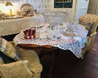 antique round table, with large American Fostoria punch bowl, base, and cups