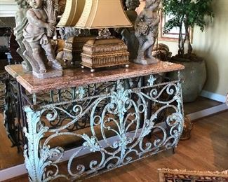 Beautiful Iron credenza with marble top, fabulous lam and two decorative putti Faux planter in fabulous planter - very edge of one of the nice rugs