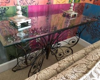the iron butterfly glass top table with a pair if lamps and a glimpse of the back of the slipper love seat