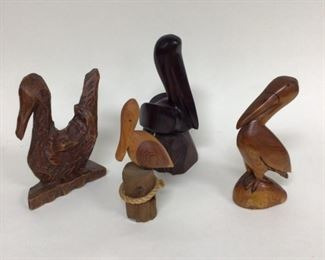 Collection of wood carved pelicans