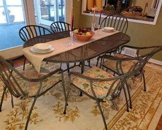 Patio Table, metal, with cushions, seats 6, space for umbrella. Excellent condition