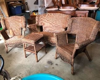 """Wicker set includes loveseat, (2) armchairs, coffee table and (2) side tables! Loveseat measures 51""""W"""