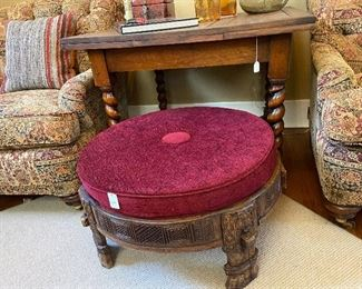 Vintage expandable table with barley twist legs.  Beautiful carved wooden round ottoman with cushion.