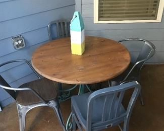 Table with wood top and iron base, metal chairs - will sell separately or as a set.