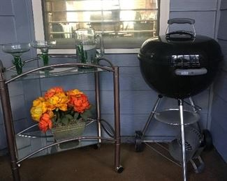 Webber grill - never used and comes with cover.  Nice bar cart!!