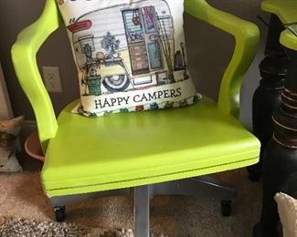 Vintage desk chair with a fun pop of color.  Tons of neat throw pillows all over the house.