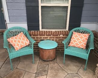 Cute and comfy!!!  Chairs are plastic wicker pattern perfect for outdoor conditioning.  Very cool table with storage.