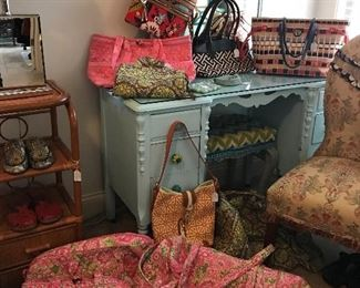 We have several Vera Bradley pieces in many sizes, shapes, patterns and colors.  We also have several Spartina 449 purses in like new condition.