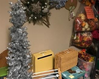 Vintage sewing machine, wicker basket, metal stool, aluminum tree, and wreaths for all seasons.  Like fall?  We have a wide variety of decorative pumpkins: art glass, metal, ceramic and plastic.