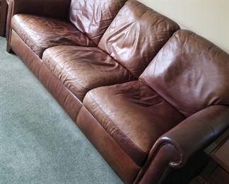 Brown leather sofa ~ $250