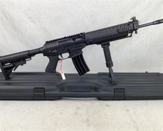 """Serial - JS005430 Mfg - Sig Sauer Model - 556 Caliber - 5.56 NATO Barrel - 16"""" Capacity - 30 Type - Rifle, Semi Automatic Located in Chattanooga, TN Condition - 3 - Light Wear This is a like-new Sig 556, and it comes with all the in box paperwork to show it! It comes equip with a front sight post and a vertical fore grip."""