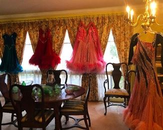 The house is festooned with feathered dance dresses!