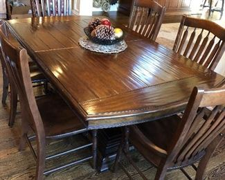 Available for presale! Text at (708)846-0259 to inquire. Wonderful double pedestal wood table + 8 chairs + 2 leaves