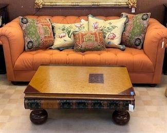 tufted orange sofa
