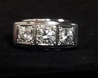 https://ctbids.com/#!/description/share/721135 **There is a reserve of $2,500 for this ring. If the ring does not meet the reserve price, the owner will consider the highest bid but is not obligated to accept it.**  Men's three stone diamond ring with diamonds totaling approximately 1.75 carats set in a 14k white gold band. Size 12. The clarity is I1 and the color is H-J. Approximate retail value is $4,500. The sides of the band have a brushed texture that tapers to a smooth surface on the bottom portion of the ring. Absolutely stunning! The information on the diamonds and value was provided by a gemologist at Windsor Jewelers in Augusta, GA. See photos for measurements. **By bidding on this item, you are agreeing to purchase it if you have the highest bid. Do NOT bid on any item if you do not intend to complete the purchase.**