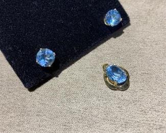 14 karat blue topaz pendant and Topez stud earrings.