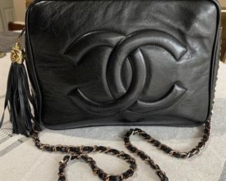 Chanel Crossbody small black leather flap with tassel. Bag in very nice condition 6 x 6, can not authenticate.