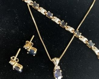 Sapphire and diamond necklace, bracelet and stud earrings. The chain says Italy 925 and 18 inches. The bracelet is stamped FAS 925 and is 7 inches. The pendant is stamped FAS 925. Pendant and earrings appear to have one tiny diamond each and bracelet one between each sapphire.