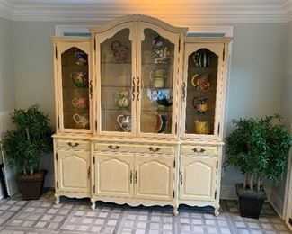 Beautiful cabinet with collection of pitchers.