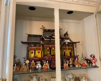 "#2. $595 unusual Pagoda doll house 34""L x 24""H with carved wood figures."