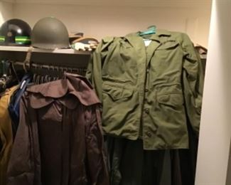 Army and air force uniforms and army jackets . Helmets and hats (female)