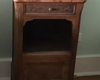 Bedside table rosewood with marble top. Matching rosewood carved bed. Selling separate. Purchased Gargoyles and Griffin from Europe $250